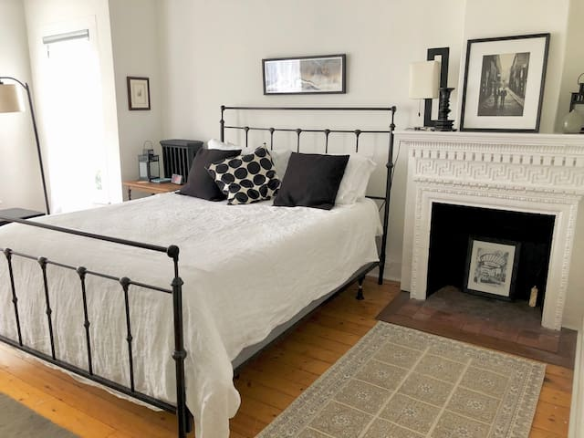 The Birch Room features a brand new queen Leesa bed and a decorative fireplace.
