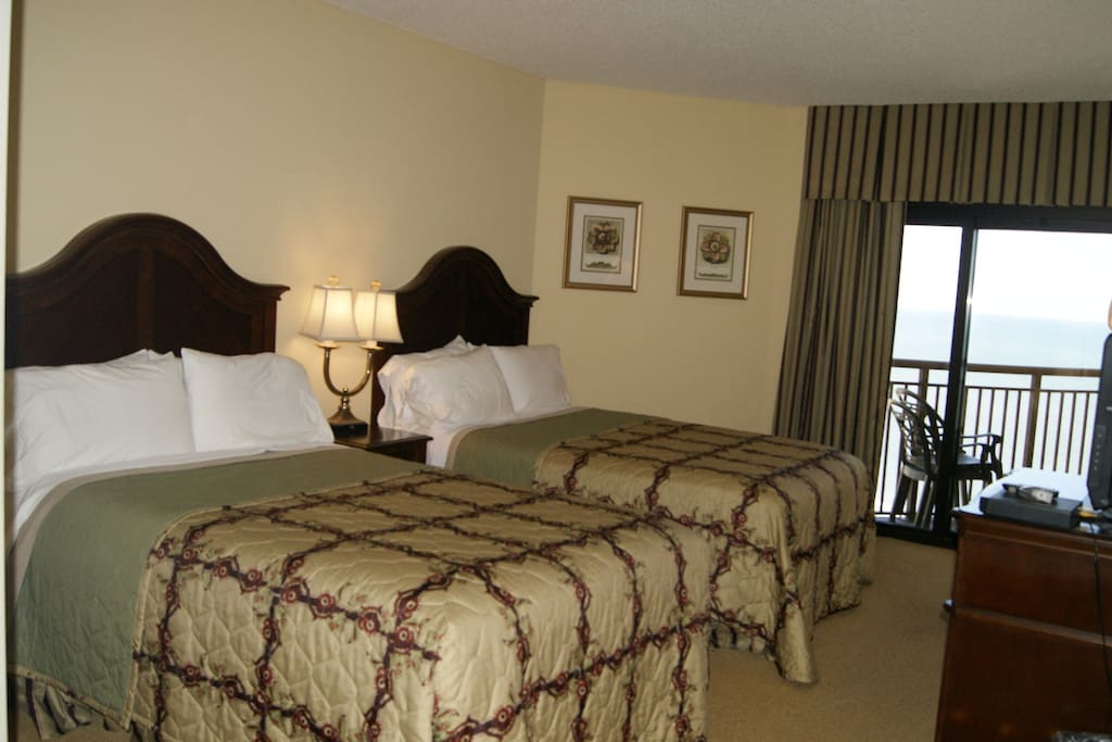 2nd Bedroom has 2 queen beds, a balcony and a magnificent ocean view!
