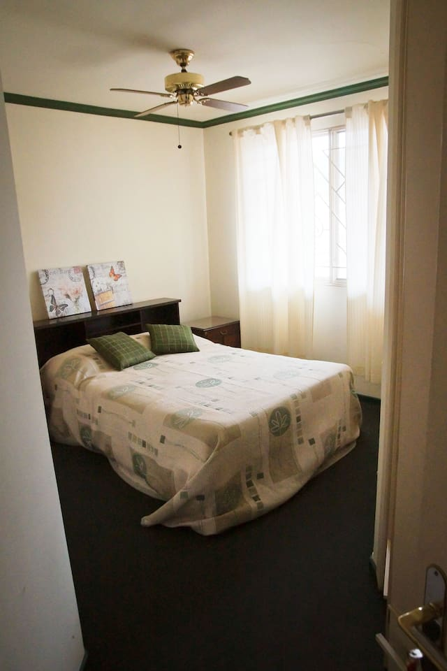 The bedroom with full-sized bed.
