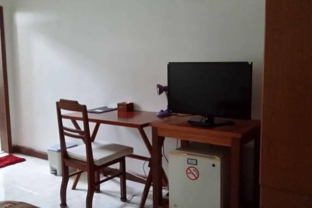 Fridge, cable television, wardrobe and desk