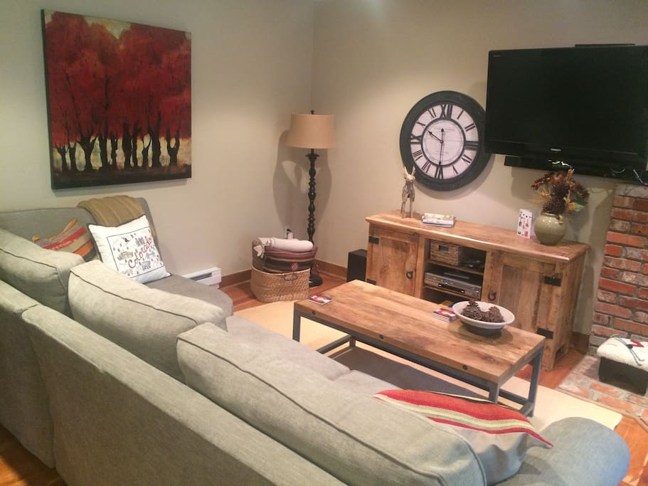 Living Room with sleeper sectional, cable TV & DVD player