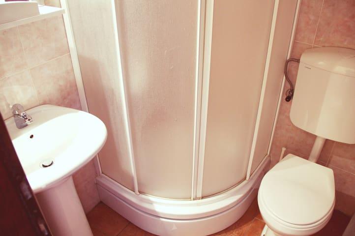 * the bathroom *