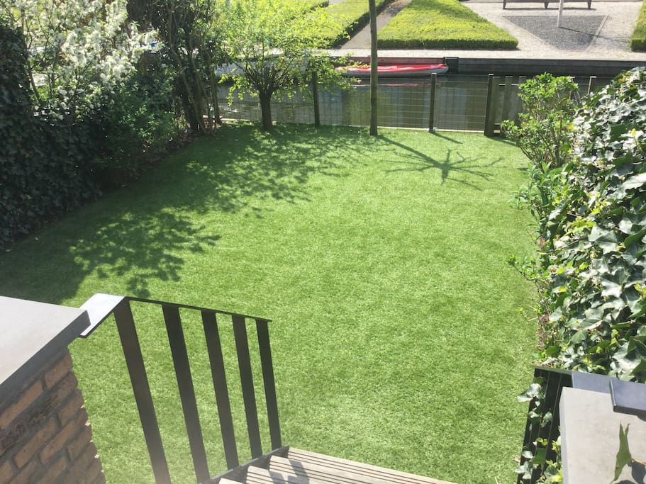 Sun , South facing garden with artificial grass for all year round use.