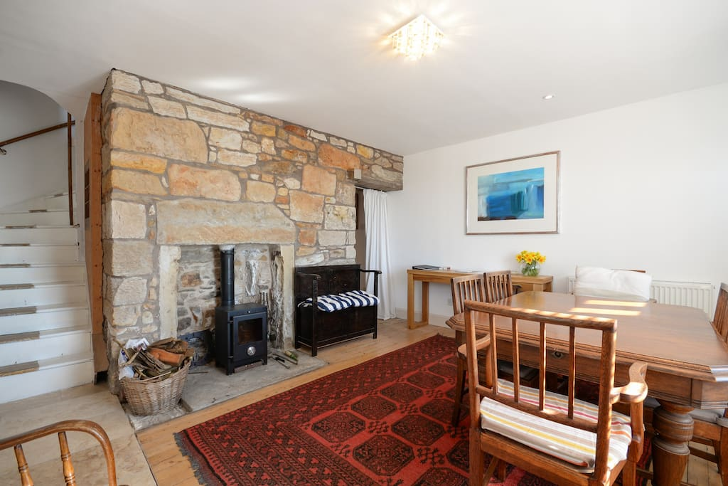 Ground Floor living room and dining room with wood burning stove and sea views across the harbour