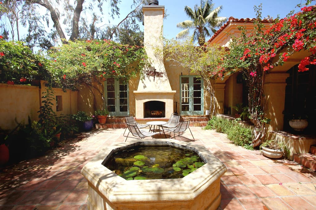 Courtyard with fountain and log burning fireplace