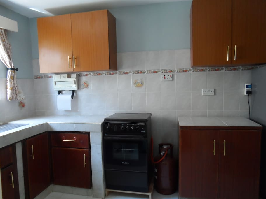 Kitchen equipped with gas cooker, fridge , microwave and cutlery