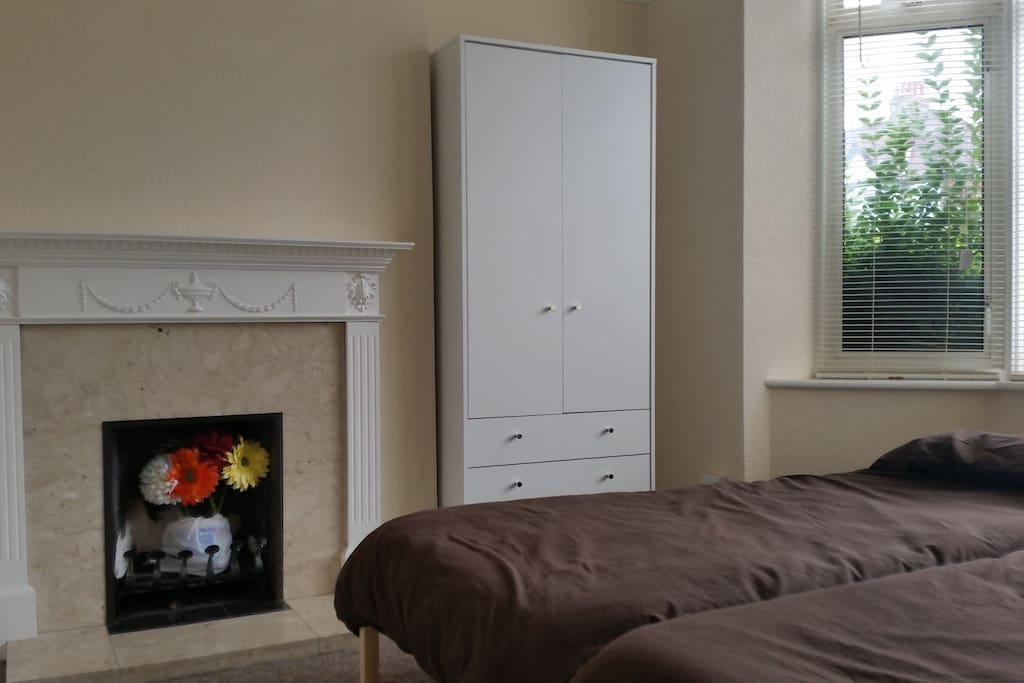 2 single beds and wardrobe