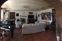 The salon with the grand piano and satellite TV