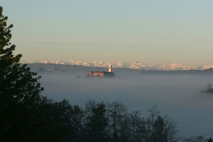 The castle of Montegrosso d'Asti viewed from the house in the morning mist