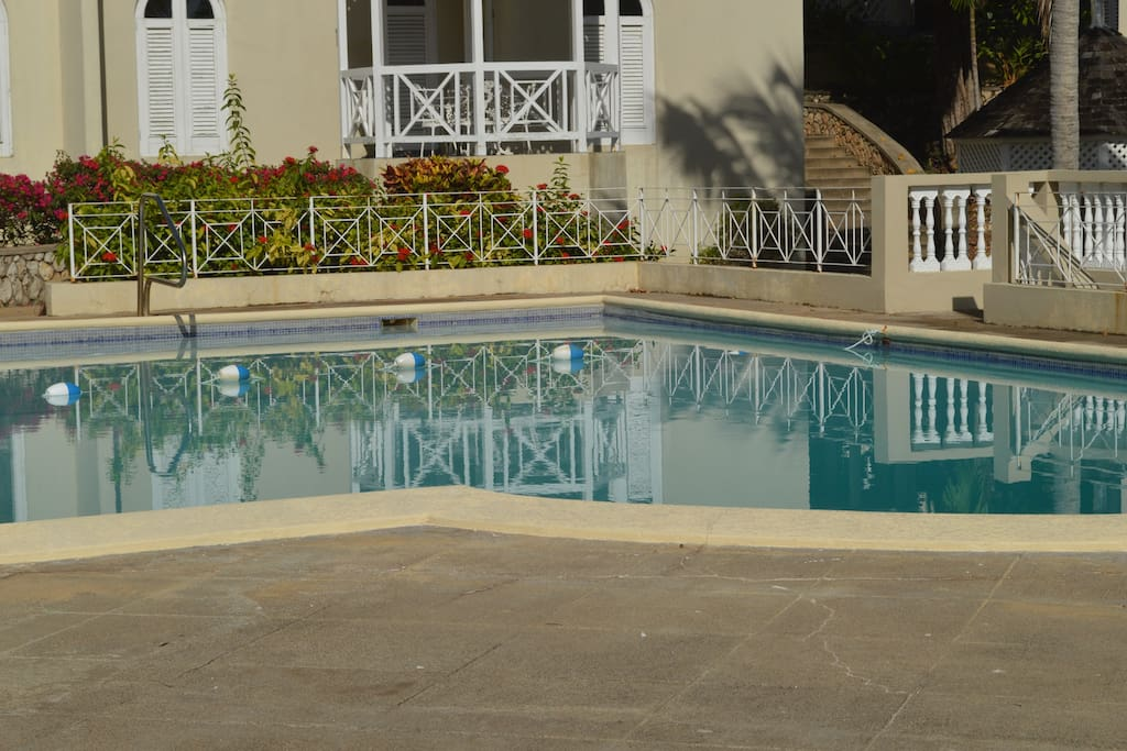 Pool located directly next to apartment.