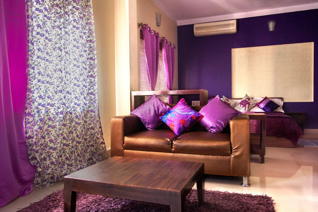 The two seater couch in the purple suite