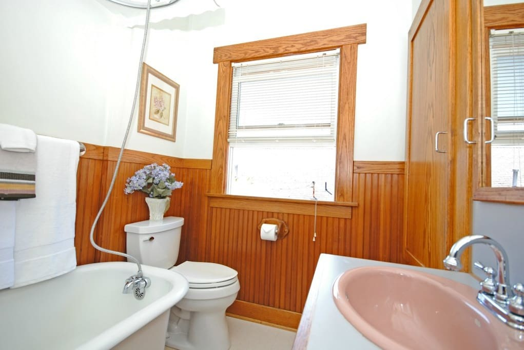 Shared bathroom with shower/tub.