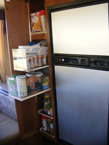 Refrigerator with pantry open.