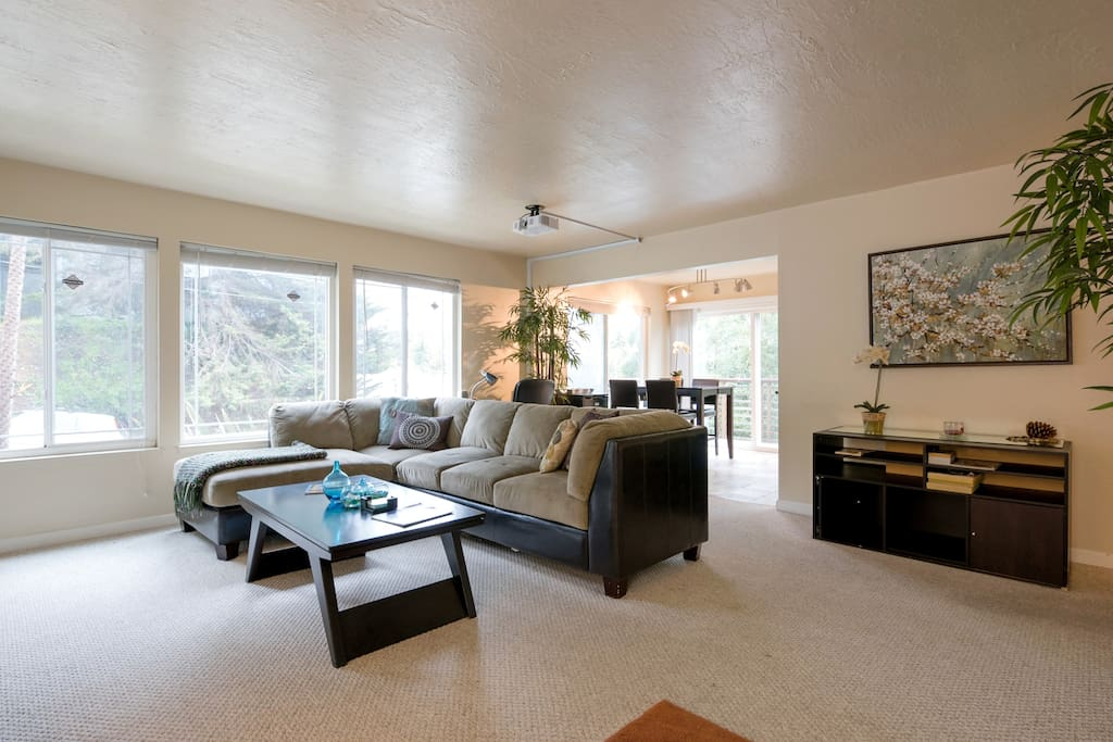 Enjoy Spacious Living Room with  Large Windows for Natural Light w/ Home Theater