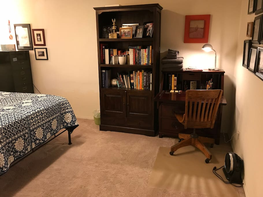 Private room with Queen Size Bed, writing desk and closet.