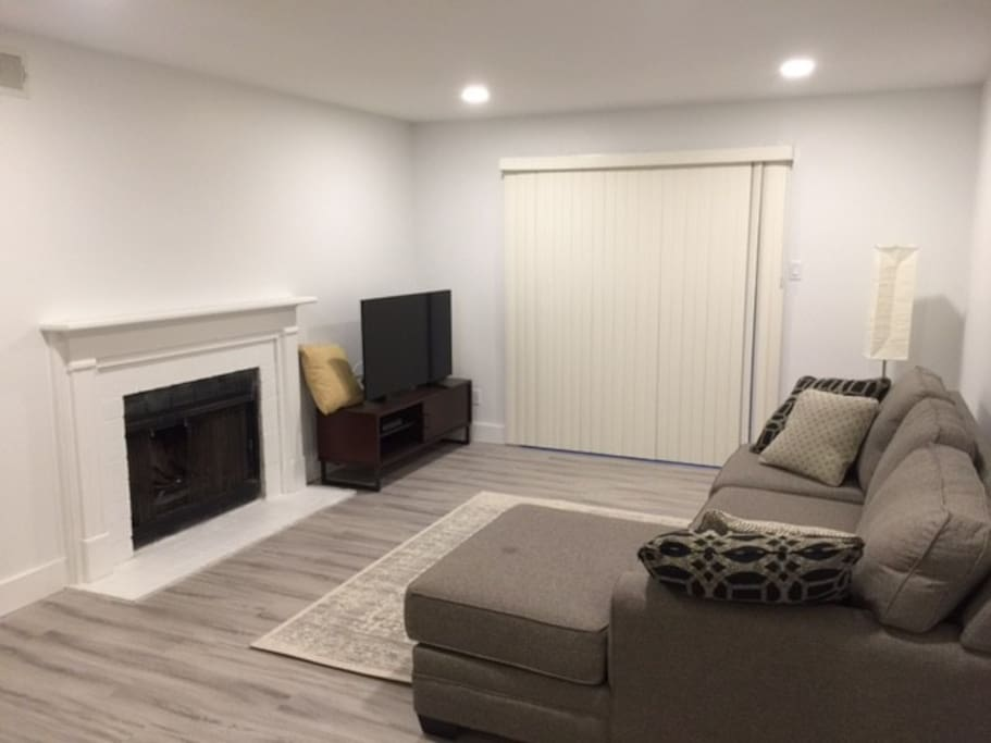 "Living room with Sectional sofa, 50"" Roku tv, recessed lighting on a dimmer, floor lamp"
