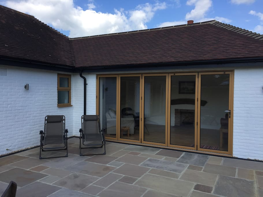 Folding doors to the sitting room
