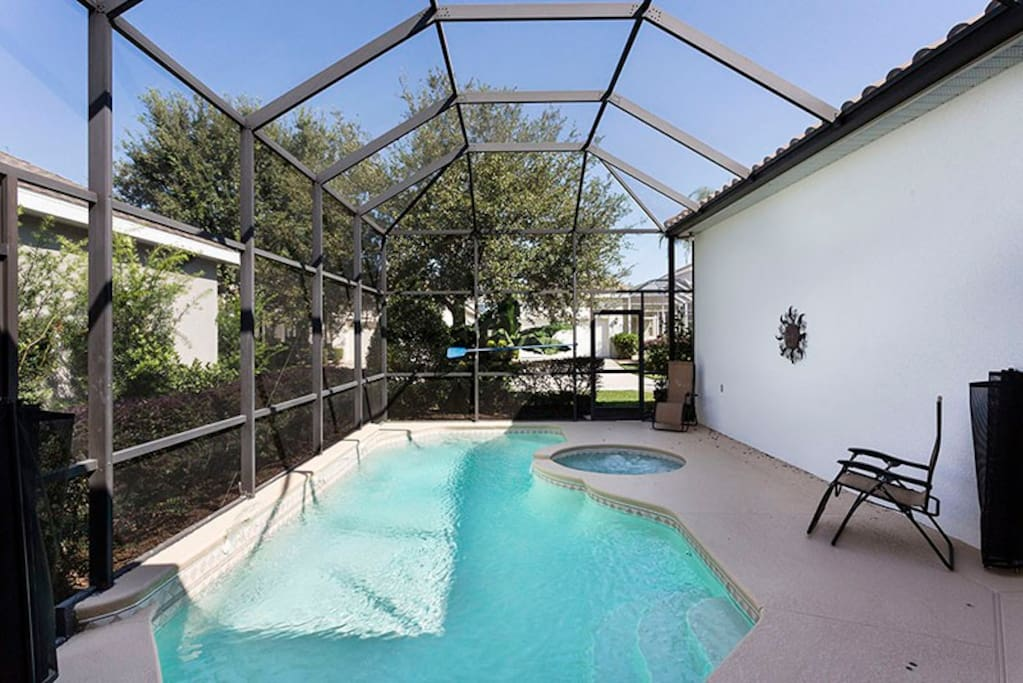 Bask in the Florida sun out in your private screened in pool