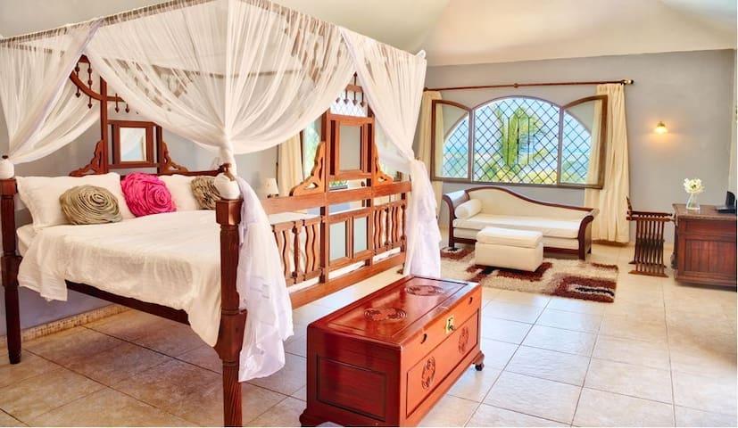 ensuite master bedroom on first floor with ocean view