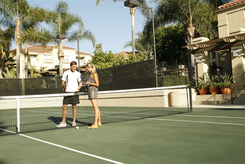 A small tennis court located inside the community