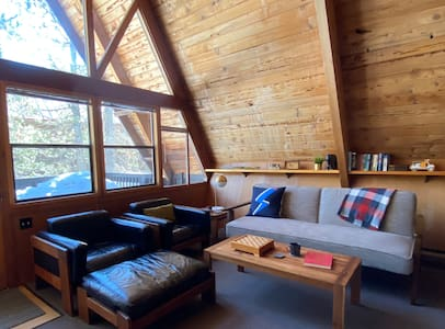 Mid-Century Modern A-frame cabin by the lake