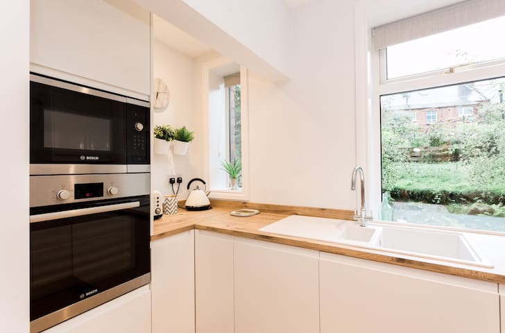 Kitchen with built in Bosch microwave and single oven. Tea, coffee and sugar supplied free of charge.