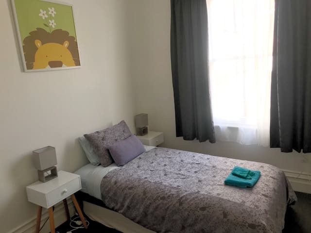 Second bedroom has a king single bed and a  trundle single which can be lifted up to normal height.