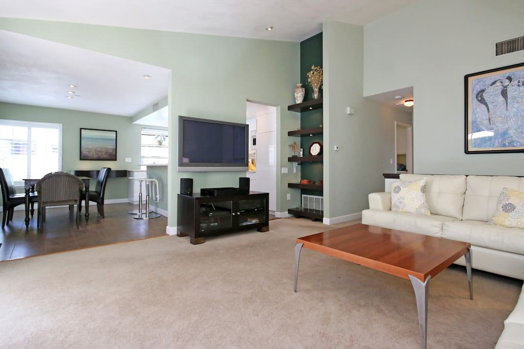 Plasma TV, with Dish Network. Dining table seats 6. Lighted bar and bookcases. Spacious kitchen