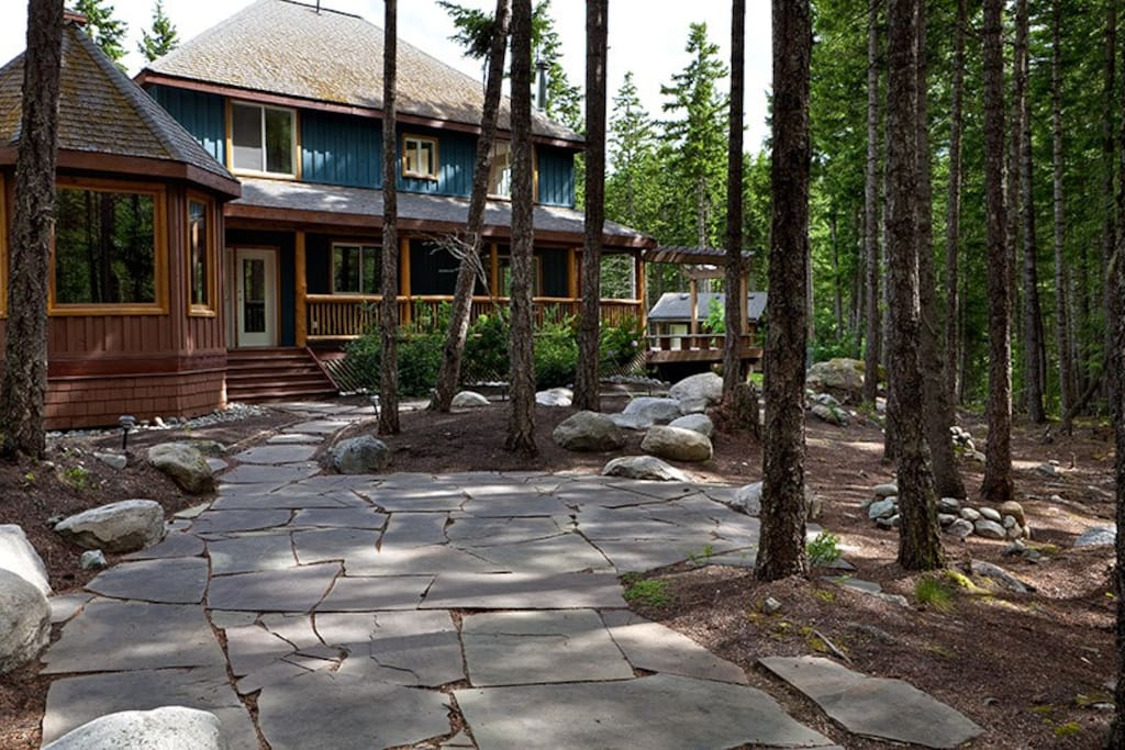 Rear of the house with landscaped area in the forest