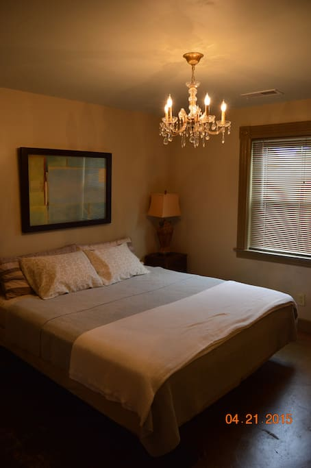 King size bed, 1940's crystal chandelier, original wood trim from the neighborhood circa 1890's.