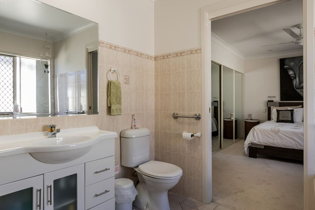 Large bedroom room with private adjoining bathroom