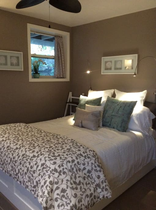 Queen bed with excellent reading lights and views to private garden