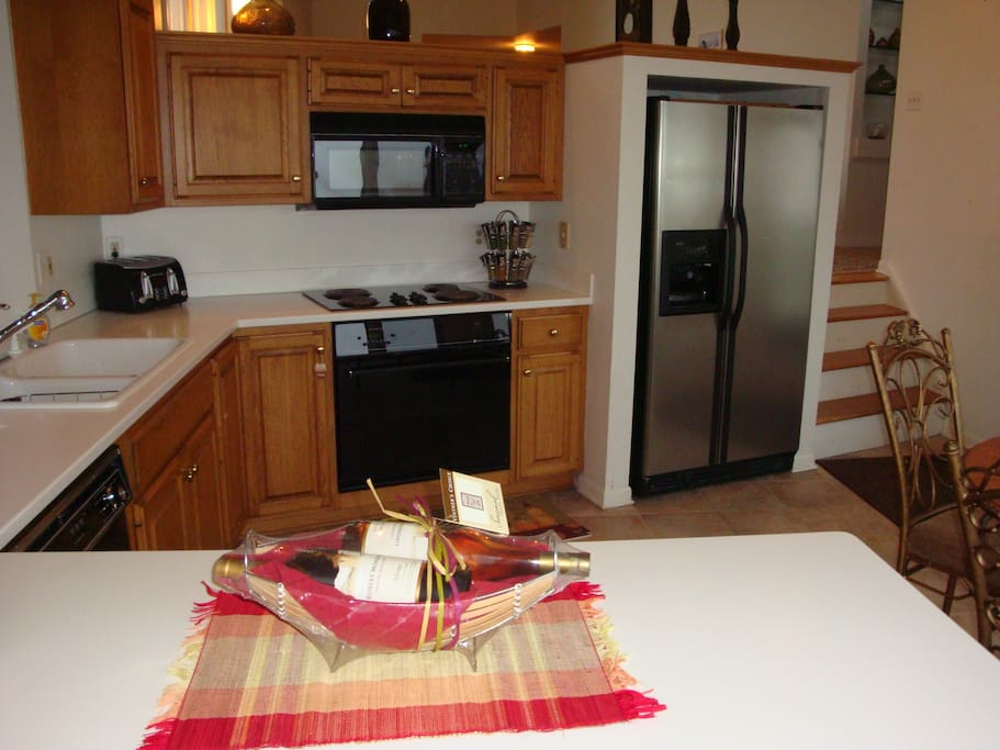 Fully stocked kitchen features a dishwasher