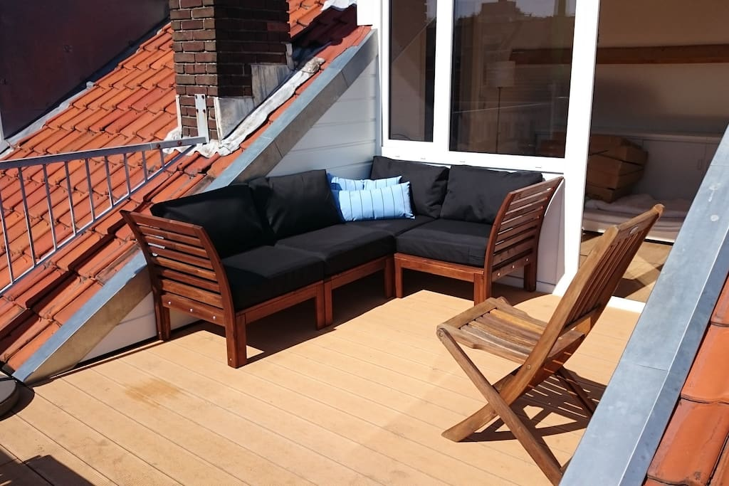 Sunny terrace with loungeset en diner tabel