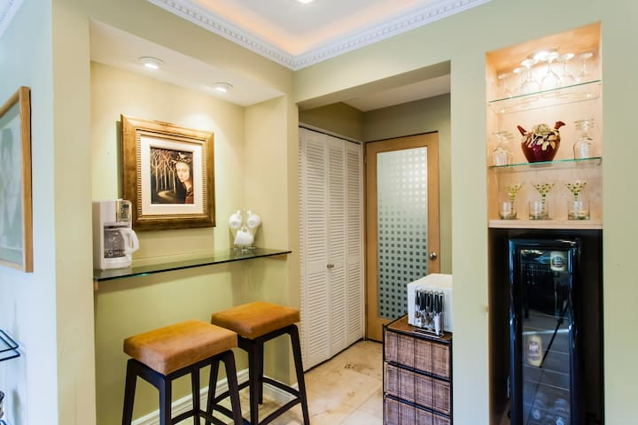 Breakfast Bar, Laundry Room, entrance to bathroom, microwave