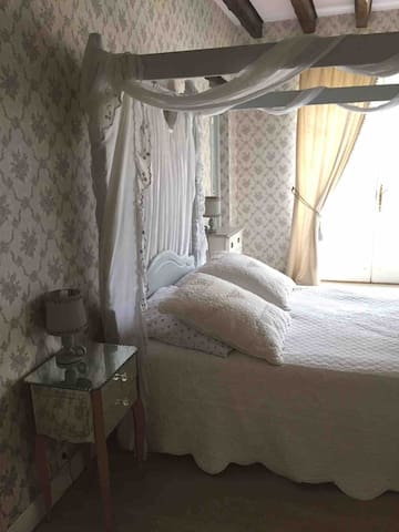 Downstairs bedroom with four poster bed