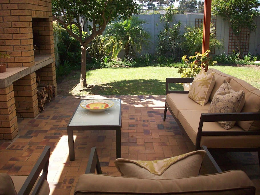 Shaded patio with outside fire place