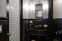 Bathroom: Marble floor and Vanity