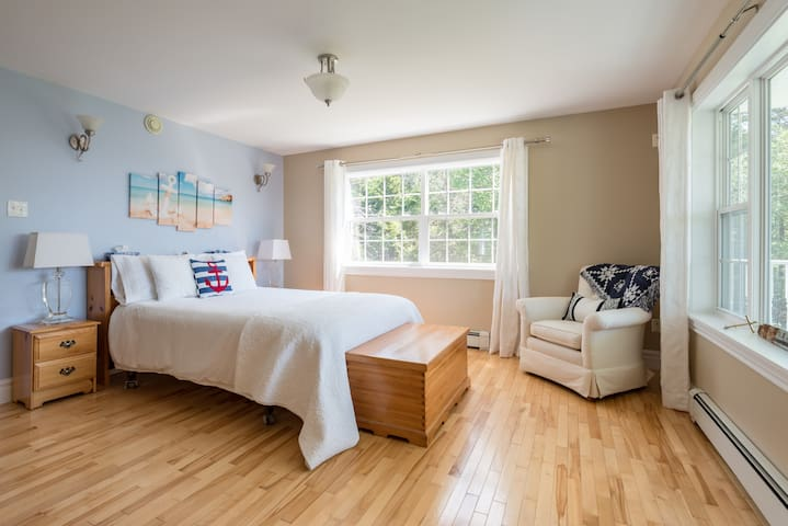 Wake up to the sunrise and birds chirping through the east facing master bedroom windows.