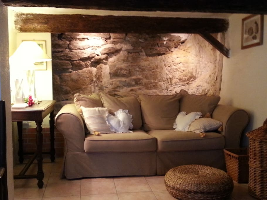 The sofa with its amazing real rock wall