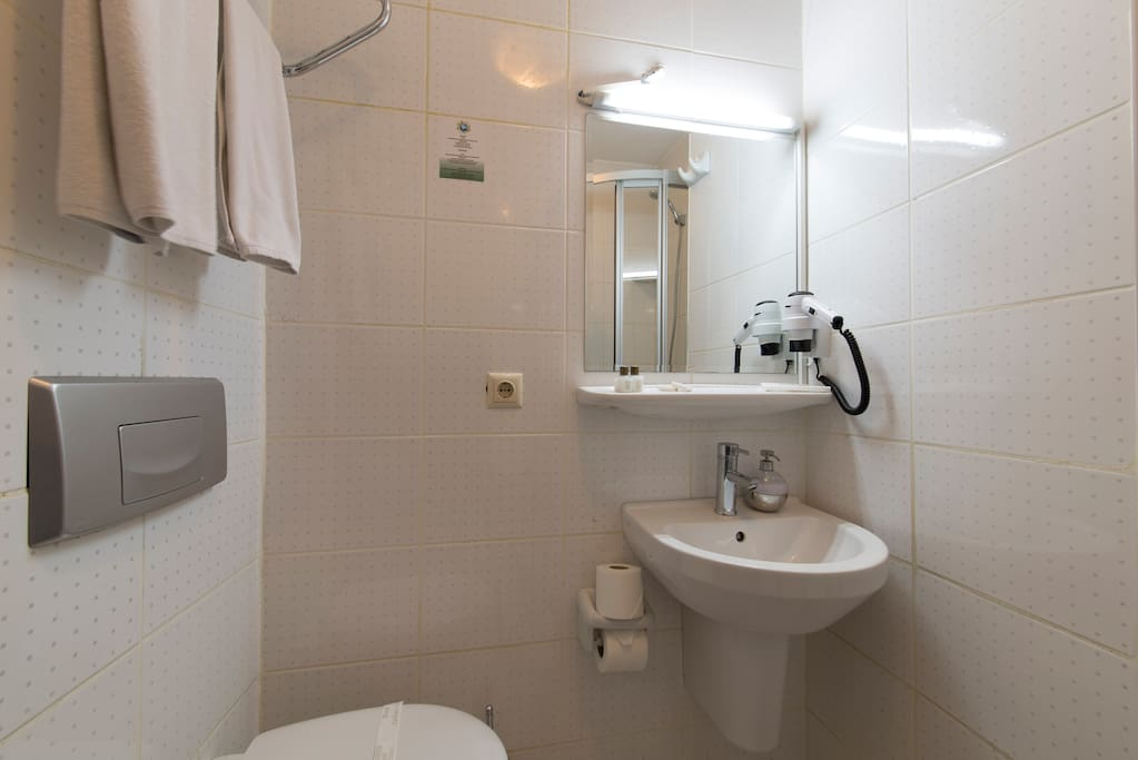 Spacious bathrooms with cabin shower. Complimentary soap, shampoo, slippers, towels, hair-dryer.
