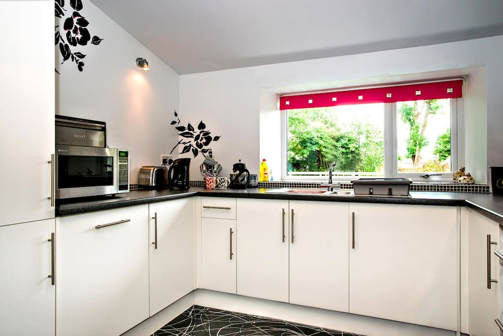 Light bright well equipped kitchen with all you need for your holiday