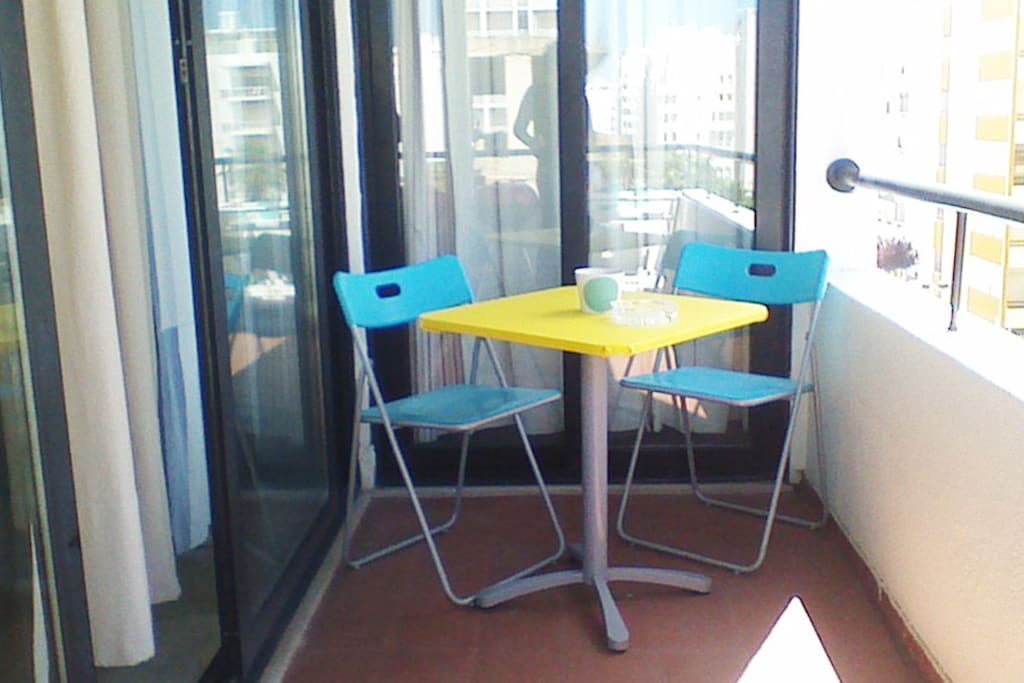 Small table on the balcony, great for small meals and watching the sunset.