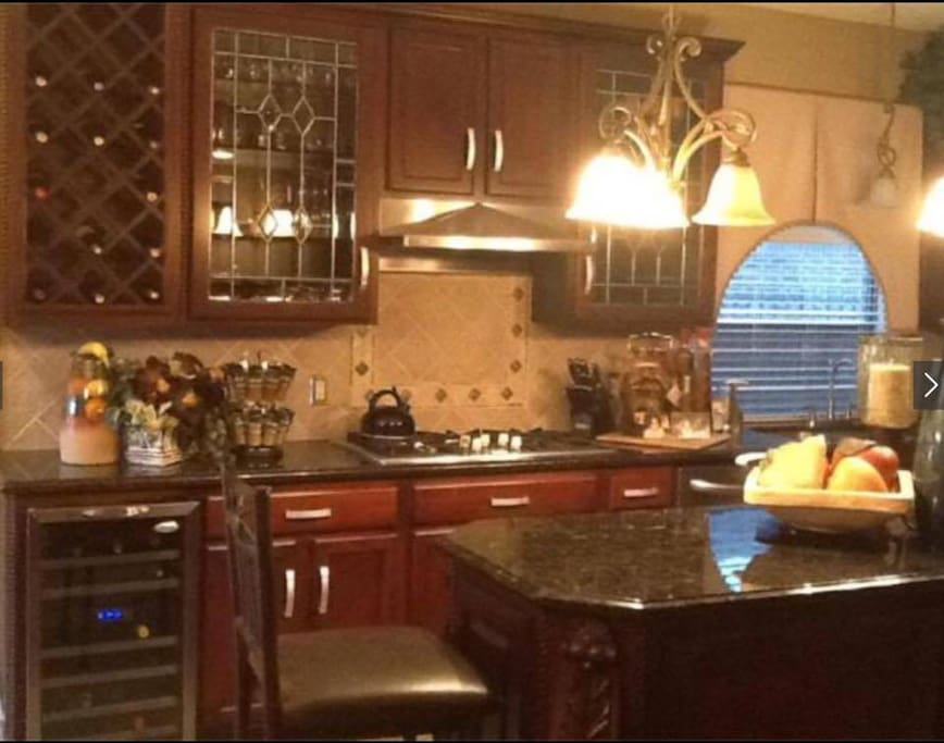 Very Large kitchen. Dinner table is located to the left and seats 4.