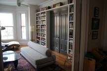 Front living room and library. The sofa is by Design Within Reach and is a very comfortable sleeper, which allows for more flexible sleeping arrangements.