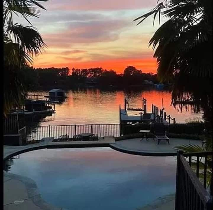 Oasis heated pool with swim up bar, full outdoor kitchen, large dock and sunsets