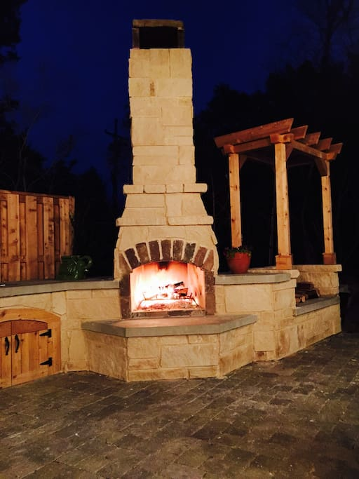 Gather around the outdoor fireplace on fall nights.