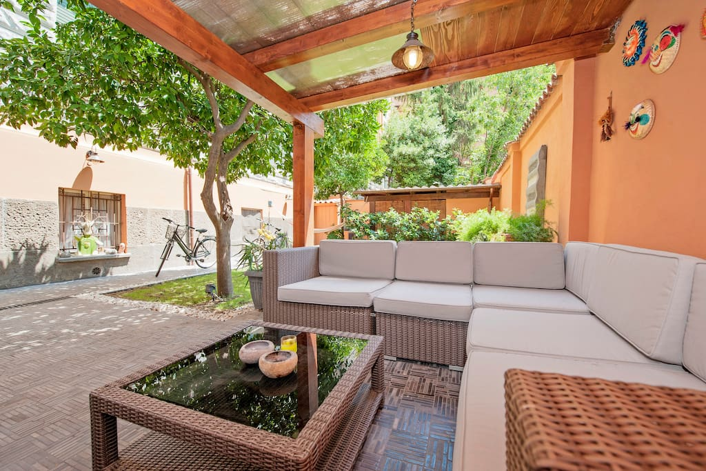 private garden with sunbeds, sofa, etc...
