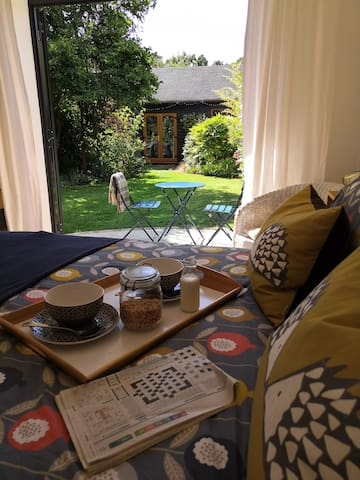 Breakfast in bed with view to the garden