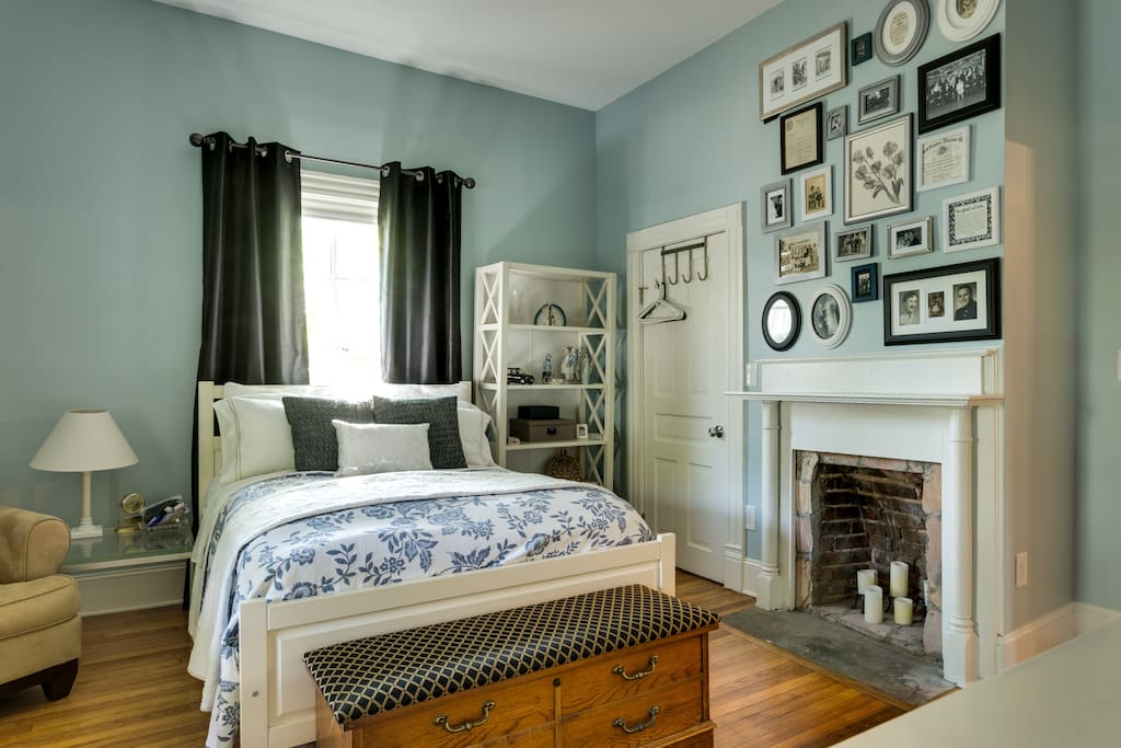 Charming guest room with blackout drapes